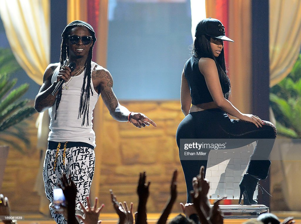 Rapper Lil Wayne (L) and recording artist Nicki Minaj perform during the 2013 Billboard Music Awards at the MGM Grand Garden Arena on May 19, 2013 in Las Vegas, Nevada.