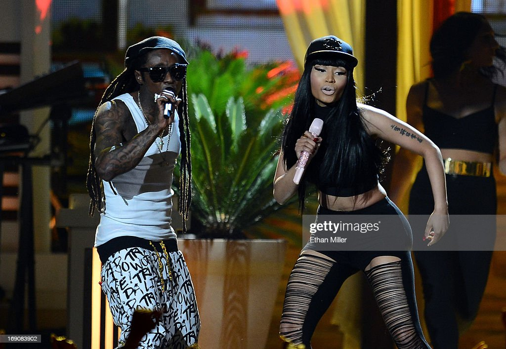 Rapper Lil Wayne (L) and recording artist Nicki Minaj perform onstage during the 2013 Billboard Music Awards at the MGM Grand Garden Arena on May 19, 2013 in Las Vegas, Nevada.