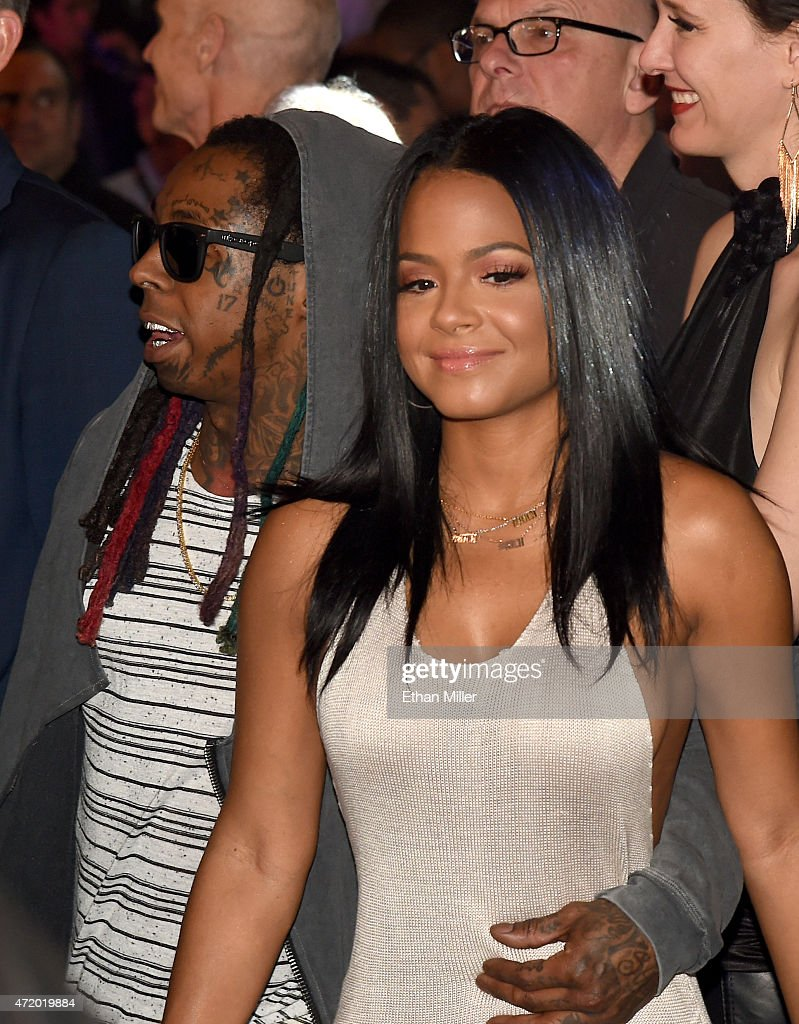Rapper Lil Wayne and singer/TV personality Christina Milian stand ringside at 'Mayweather VS Pacquiao' presented by SHOWTIME PPV And HBO PPV at MGM...