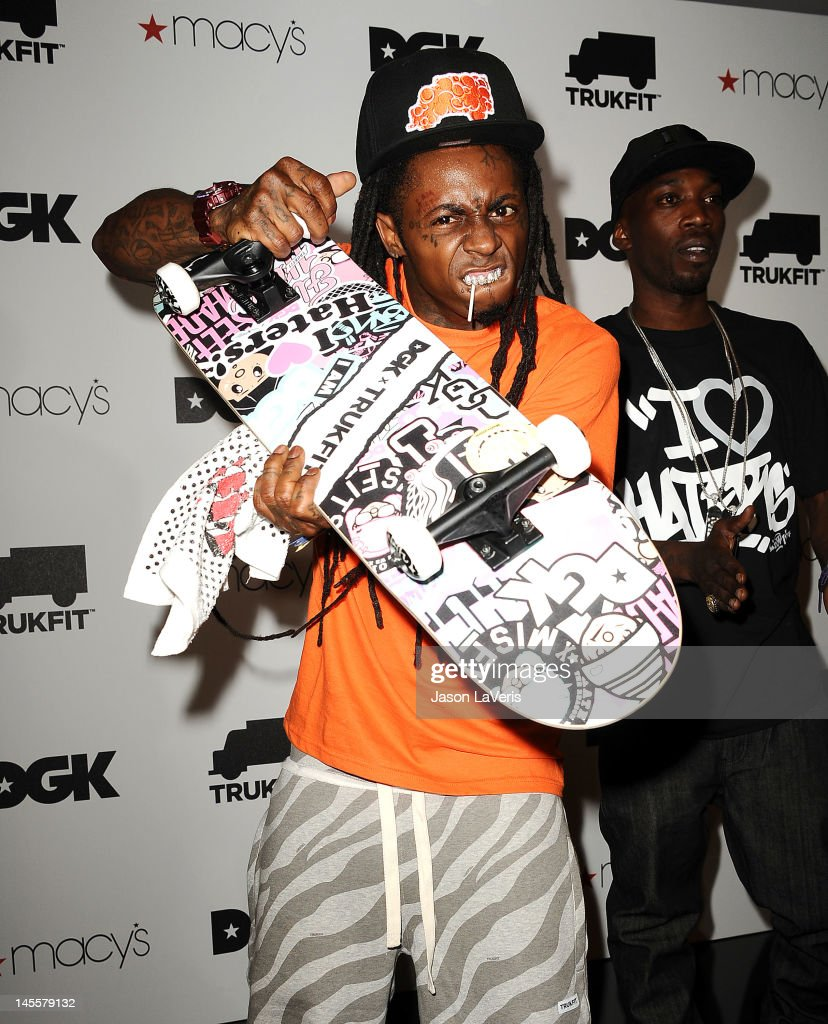 Rapper Lil Wayne and skateboarder Stevie Williams attend the launch of TRUKFIT at Macy's Beverly Center on June 1, 2012 in Los Angeles, California.