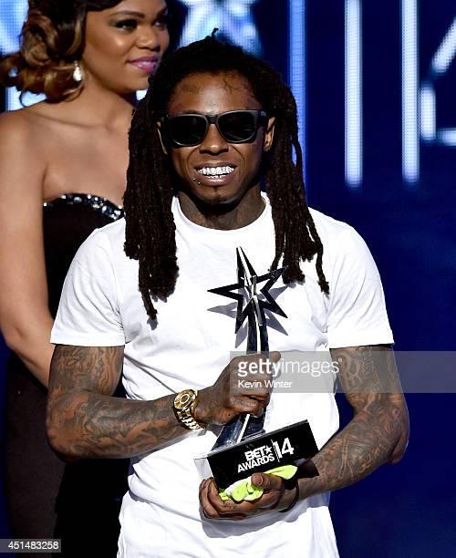 Rapper Lil Wayne holds Best Female HipHop Artist award onstage during the BET AWARDS '14 at Nokia Theatre LA LIVE on June 29 2014 in Los Angeles...