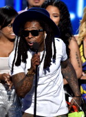 Rapper Lil Wayne of Young Money accepts Best Group onstage during the BET AWARDS '14 at Nokia Theatre LA LIVE on June 29 2014 in Los Angeles...
