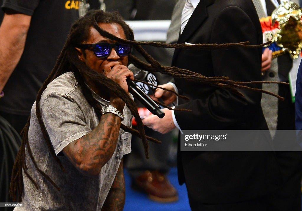 Rapper Lil Wayne performs as boxer Floyd Mayweather Jr. walks into the ring to take on Robert Guerrero in their WBC welterweight title bout at the MGM Grand Garden Arena on May 4, 2013 in Las Vegas, Nevada.