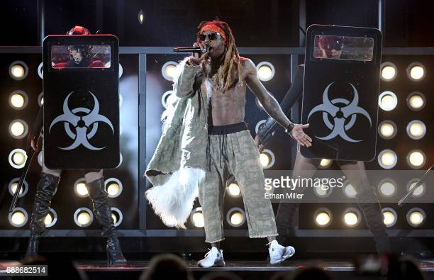 Rapper Lil' Wayne performs during the 2017 Billboard Music Awards at TMobile Arena on May 21 2017 in Las Vegas Nevada