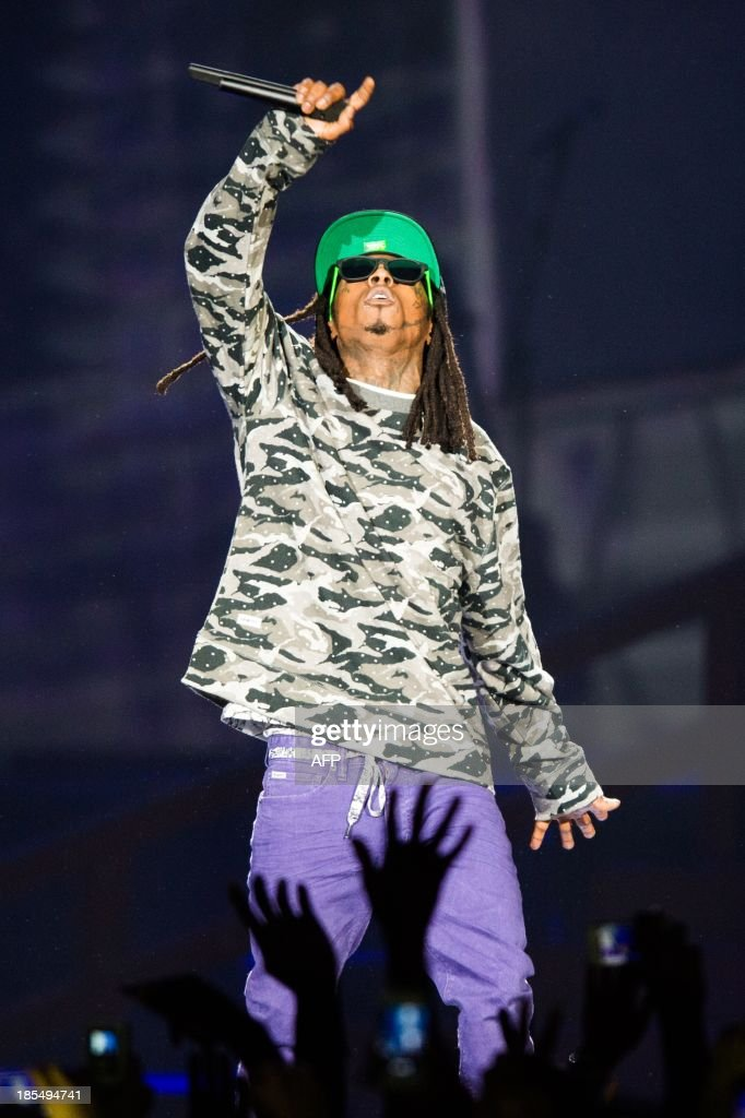 US rapper Lil' Wayne performs on stage during his concert in the Ziggo Dome in Amsterdam on October 21, 2013. AFP PHOTO / ANP / FERDY DAMMAN netherlands out