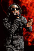 Rapper Lil Wayne performs onstage at the 2014 American Music Awards at Nokia Theatre LA Live on November 23 2014 in Los Angeles California