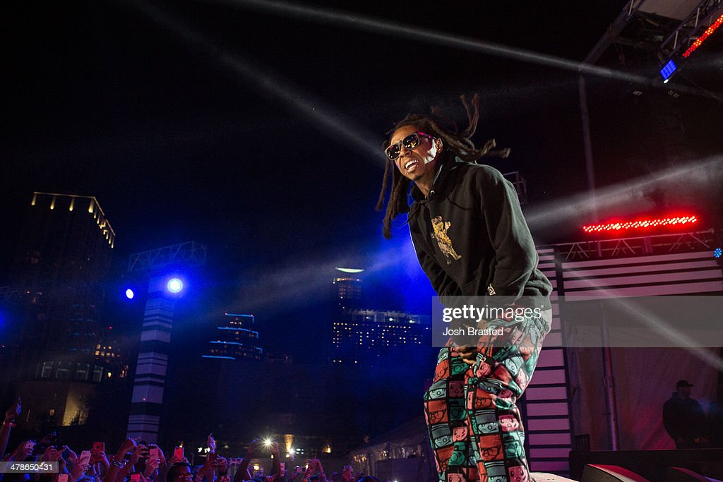 Rapper Lil Wayne performs onstage at the 2014 mtvU Woodie Awards and Festival on March 13, 2014 in Austin, Texas.