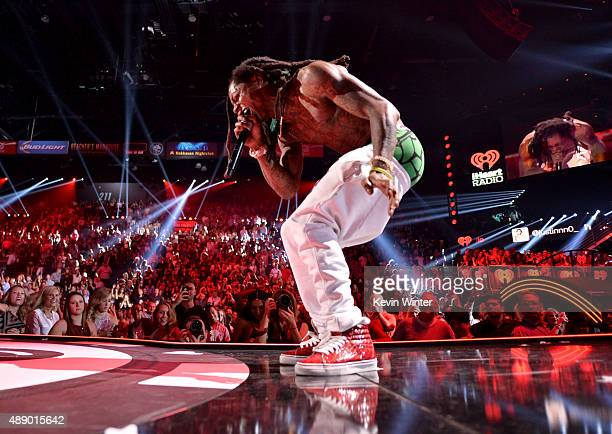 Rapper Lil Wayne performs onstage at the 2015 iHeartRadio Music Festival at MGM Grand Garden Arena on September 18 2015 in Las Vegas Nevada
