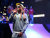 Rapper Lil Wayne performs onstage at the Samsung booth at E3 Expo 2016 on June 15 2016 in Los Angeles California