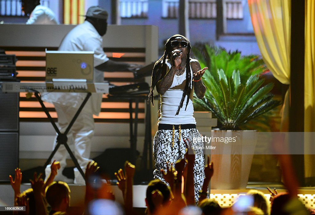Rapper Lil Wayne performs onstage during the 2013 Billboard Music Awards at the MGM Grand Garden Arena on May 19, 2013 in Las Vegas, Nevada.