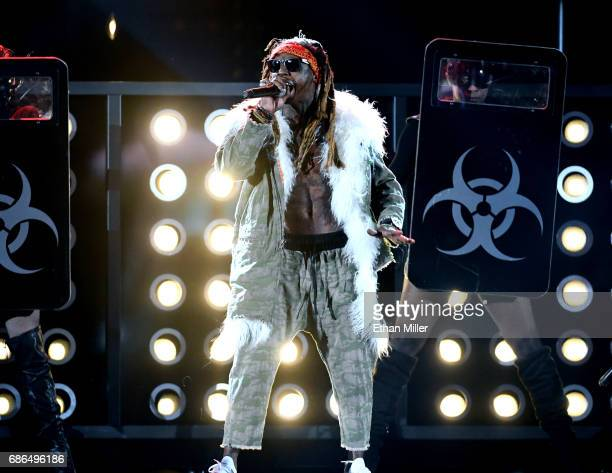 Rapper Lil Wayne performs onstage during the 2017 Billboard Music Awards at TMobile Arena on May 21 2017 in Las Vegas Nevada