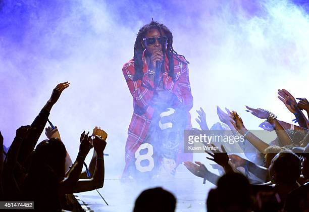 Rapper Lil Wayne performs onstage during the BET AWARDS '14 at Nokia Theatre LA LIVE on June 29 2014 in Los Angeles California