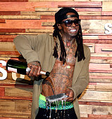 AUSTIN TX MARCH Rapper Lil Wayne pours champagne over his Samsung Galaxy S7 at Samsung Galaxy Life Fest at SXSW 2016 on March 12 2016 in Austin Texas