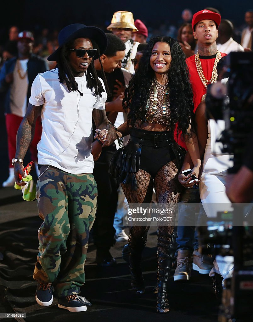 Rapper Lil Wayne, singer <a gi-track='captionPersonalityLinkClicked' href=/galleries/search?phrase=Nicki+Minaj+-+Performer&family=editorial&specificpeople=6362705 ng-click='$event.stopPropagation()'>Nicki Minaj</a>, and rapper <a gi-track='captionPersonalityLinkClicked' href=/galleries/search?phrase=Tyga&family=editorial&specificpeople=4489457 ng-click='$event.stopPropagation()'>Tyga</a> walk onstage during the BET AWARDS '14 at Nokia Theatre L.A. LIVE on June 29, 2014 in Los Angeles, California.
