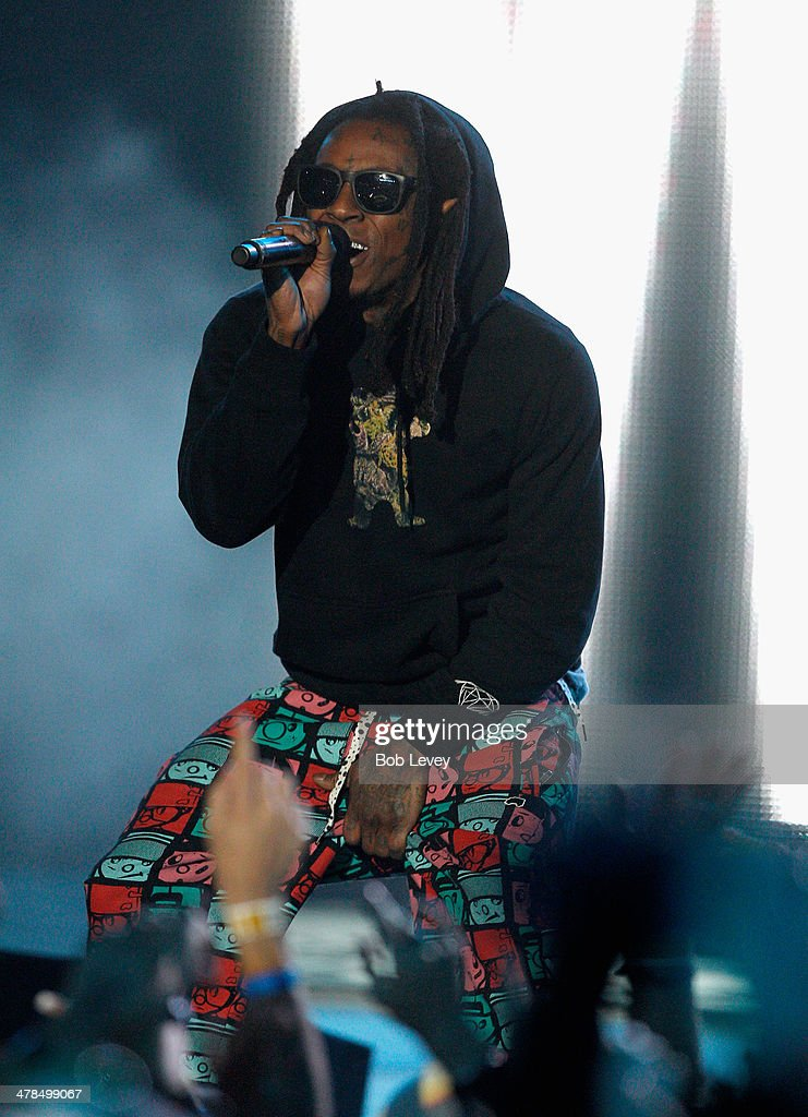 Rapper Lil Wayne speaks onstage at the 2014 mtvU Woodie Awards and Festival on March 13, 2014 in Austin, Texas.