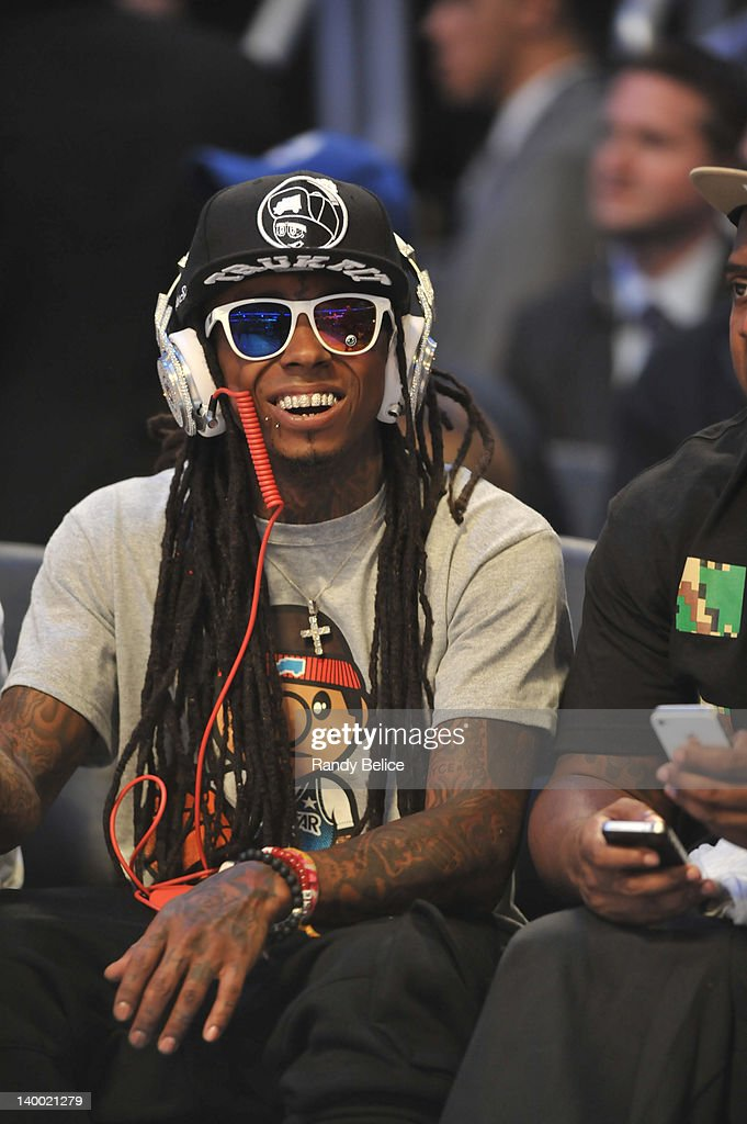 Rapper Lil Wayne watches the 2012 NBA All-Star Game as part of 2012 All-Star Weekend at the Amway Center on February 26, 2012 in Orlando, Florida.
