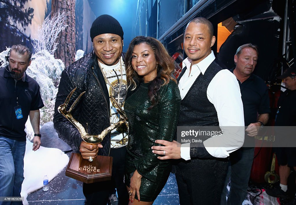 Rapper LL Cool J and cohosts Taraji P Henson and Terrence Howard pose with the GOAT award backstage during Spike TV's Guys Choice 2015 at Sony...