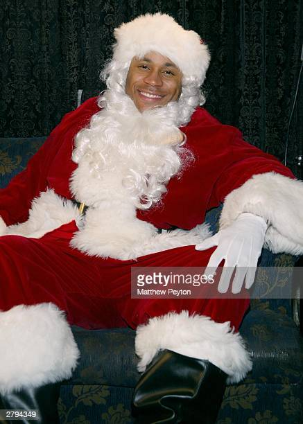 Rapper LL Cool J dressed as Santa Claus waits to celebrate at a party for 250 disadvantaged youths December 8 2003 in New York City The event which...