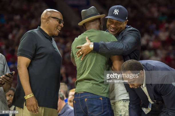 Rapper LL Cool J greets boxer Bernard Hopkins during a BIG3 Basketball league game on July 16 2017 at Wells Fargo Center in Philadelphia PA