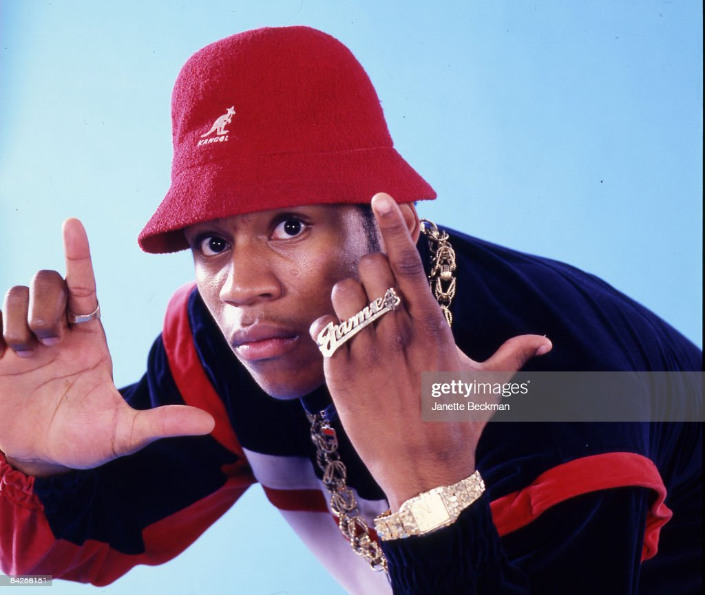 Rapper LL Cool J real name James Todd Smith makes hand gestures while posing for a studio portrait 1986 New York He is wearing a red Kangol Bermuda...