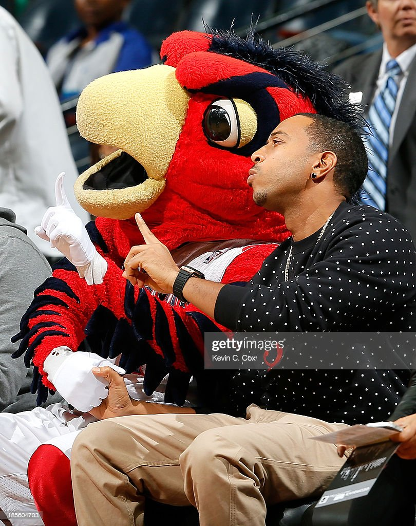 Rapper Ludacris and mascot Harry the Hawk pose for a photo during the game between the Atlanta Hawks and the Indiana Pacers at Philips Arena on October 22, 2013 in Atlanta, Georgia.