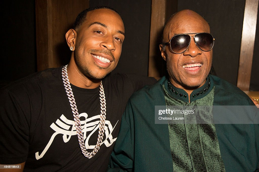 Rapper Ludacris (L) and musician Stevie Wonder pose at the For Our Girls of Nigeria benefit concert hosted by singer/actor Tyrese Gibson at 1OAK on May 30, 2014 in West Hollywood, California.