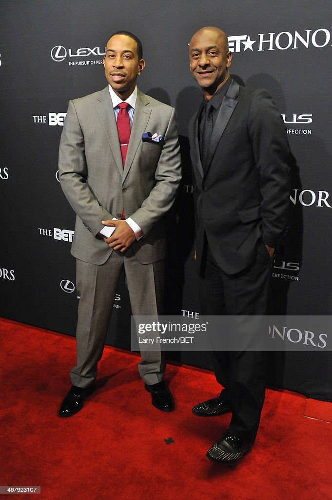 Rapper Ludacris and President of Music Programming and Specials for BET Networks Stephen G Hill attend BET Honors 2014 at Warner Theatre on February...