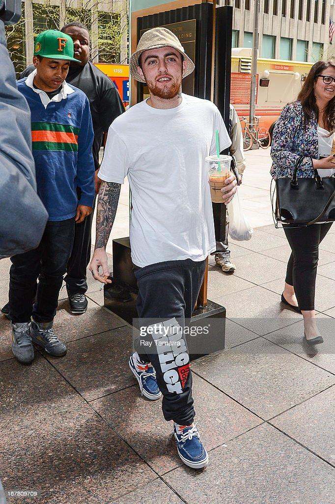 Rapper Mac Miller enters the Sirius XM Studios on April 30, 2013 in New York City.