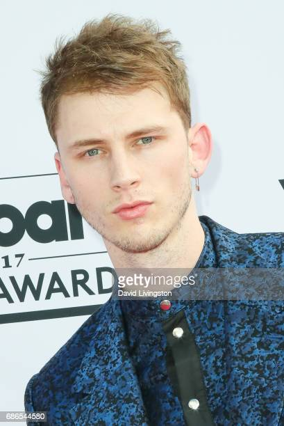 Rapper Machine Gun Kelly attends the 2017 Billboard Music Awards at the TMobile Arena on May 21 2017 in Las Vegas Nevada
