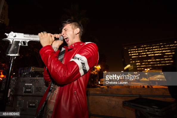 Rapper Machine Gun Kelly poses backstage during day 2 of the Made in America Festival at Los Angeles Grand Park on August 31 2014 in Los Angeles...