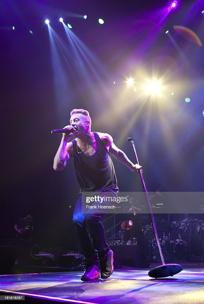 Rapper <a gi-track='captionPersonalityLinkClicked' href=/galleries/search?phrase=Macklemore&family=editorial&specificpeople=7639427 ng-click='$event.stopPropagation()'>Macklemore</a> of <a gi-track='captionPersonalityLinkClicked' href=/galleries/search?phrase=Macklemore&family=editorial&specificpeople=7639427 ng-click='$event.stopPropagation()'>Macklemore</a> & Ryan Lewis performs live during a concert at the O2 World on September 25, 2013 in Berlin, Germany.