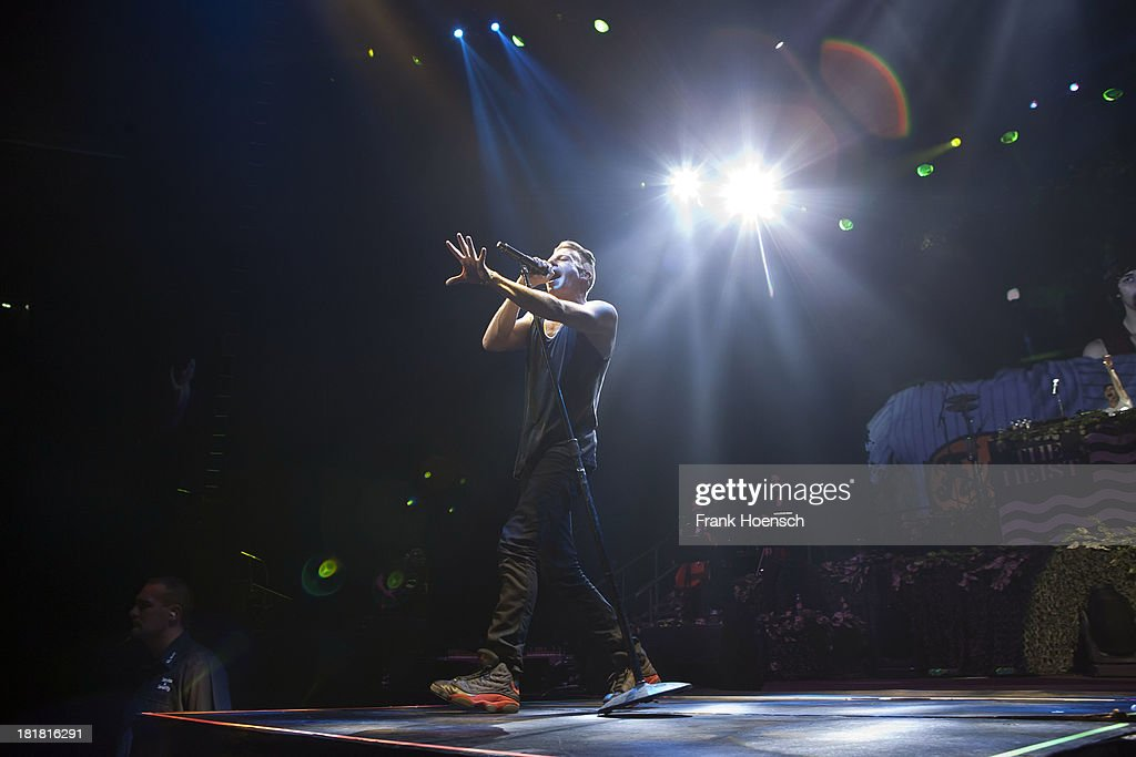 Rapper Macklemore of Macklemore & Ryan Lewis performs live during a concert at the O2 World on September 25, 2013 in Berlin, Germany.