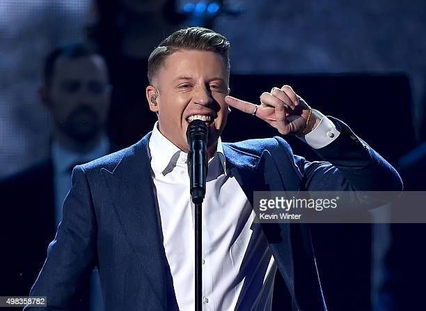 Rapper Macklemore performs onstage during the 2015 American Music Awards at Microsoft Theater on November 22 2015 in Los Angeles California