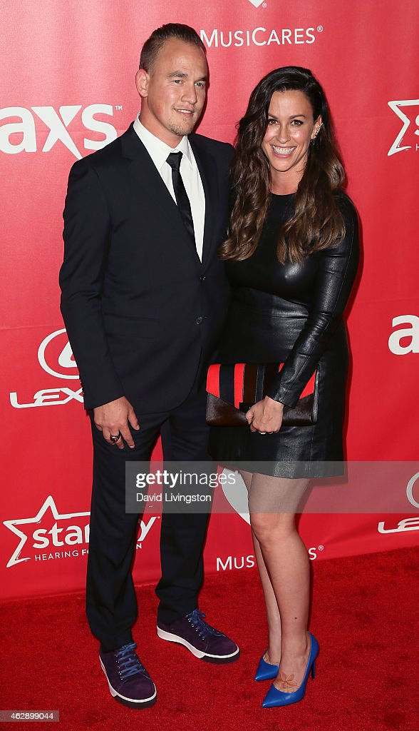 Rapper Mario Treadway (L) and wife recording artist Alanis Morissette attend the 2015 MusiCares Person of the Year Gala honoring Bob Dylan at the Los Angeles Convention Center on February 6, 2015 in Los Angeles, California.