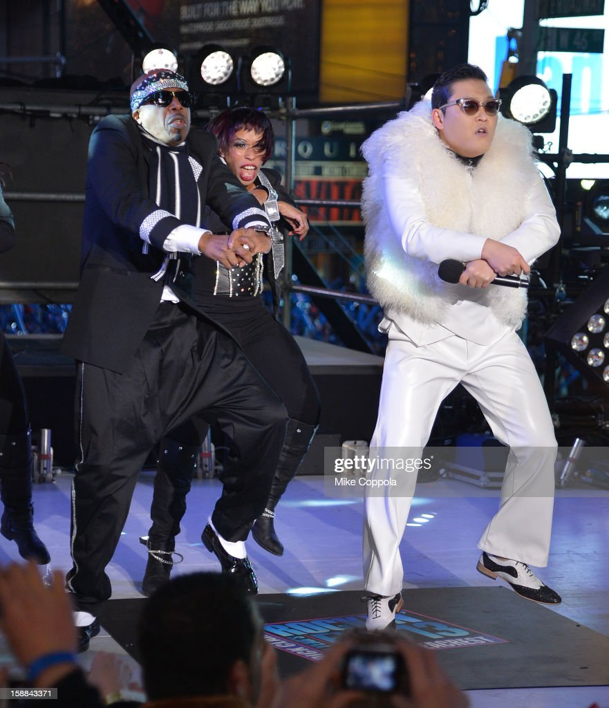 Rapper <a gi-track='captionPersonalityLinkClicked' href=/galleries/search?phrase=MC+Hammer&family=editorial&specificpeople=225081 ng-click='$event.stopPropagation()'>MC Hammer</a> (L), and Korean Rapper PSY perform during New Year's Eve 2013 In Times Square at Times Square on December 31, 2012 in New York City.