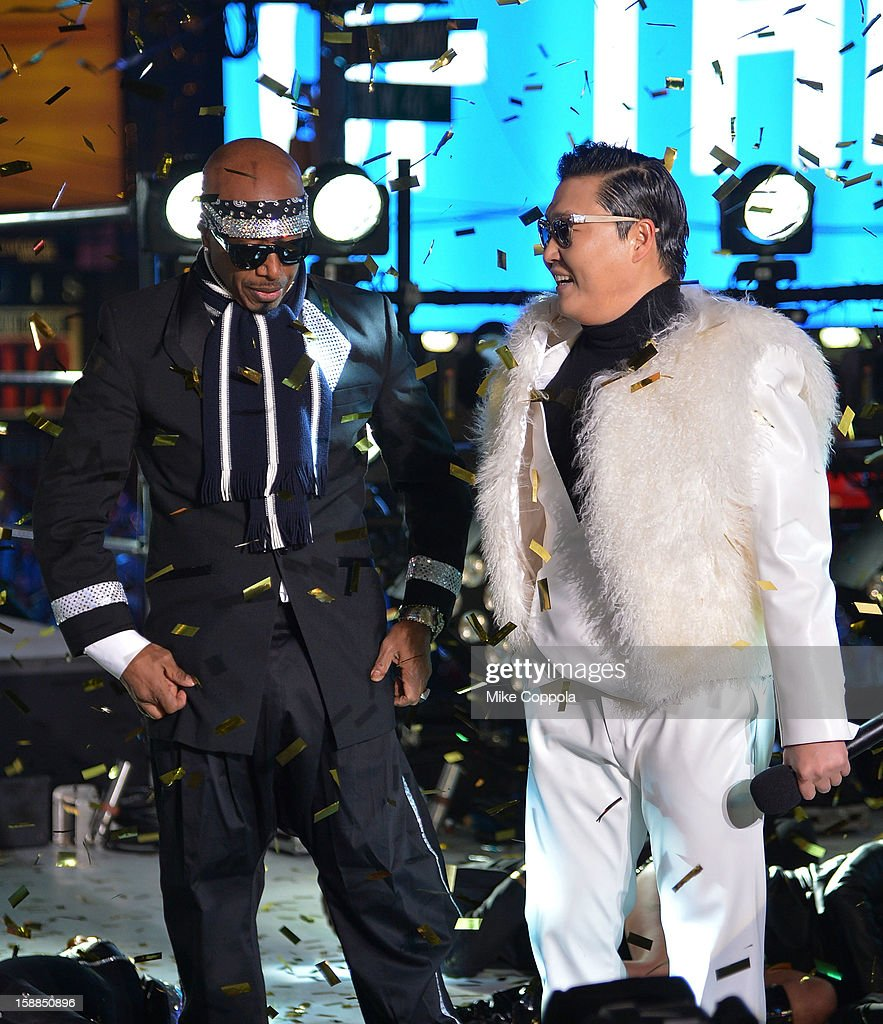Rapper MC Hammer (L), and Korean Rapper PSY perform during New Year's Eve 2013 In Times Square at Times Square on December 31, 2012 in New York City.