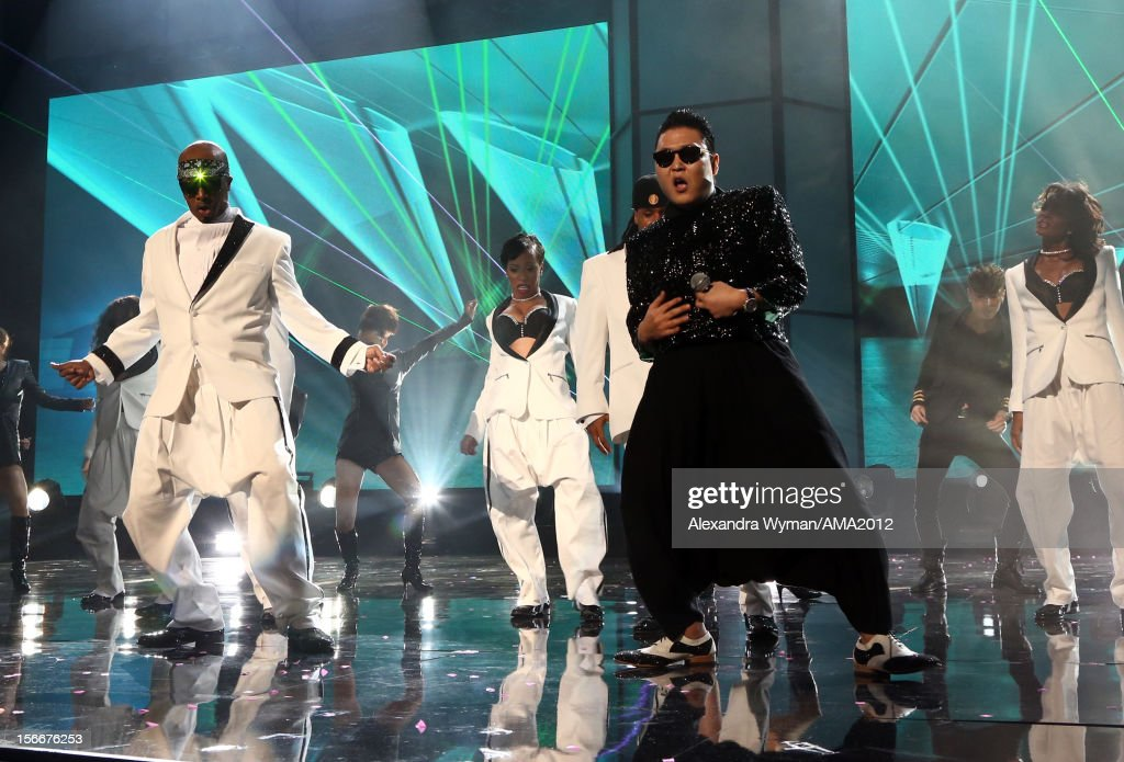 Rapper <a gi-track='captionPersonalityLinkClicked' href=/galleries/search?phrase=MC+Hammer&family=editorial&specificpeople=225081 ng-click='$event.stopPropagation()'>MC Hammer</a> and singer Psy onstage at the 40th American Music Awards held at Nokia Theatre L.A. Live on November 18, 2012 in Los Angeles, California.