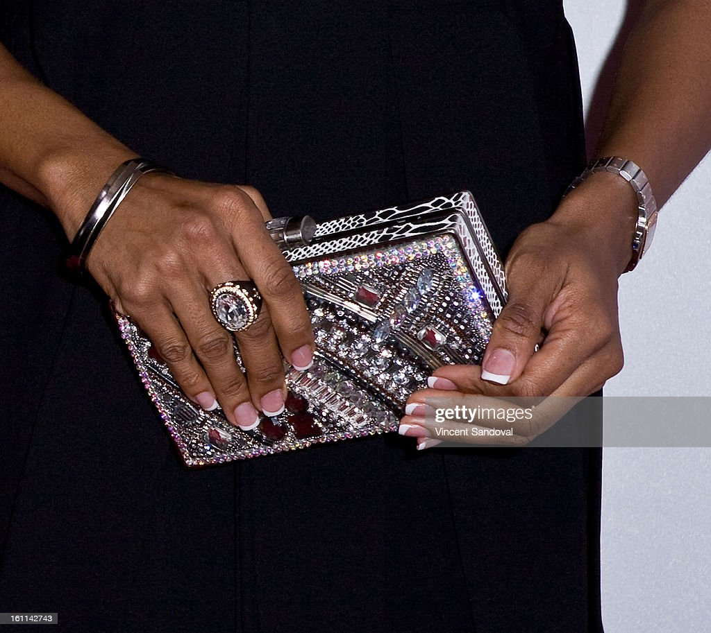 Rapper MC Lyte (purse detail) attends VIBE Magazine's 20th anniversary celebration with inaugural impact awards - Arrivals at Sunset Tower on February 8, 2013 in West Hollywood, California.