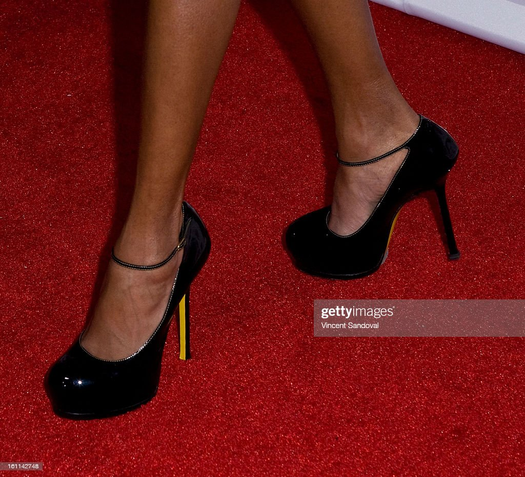 Rapper MC Lyte (shoe detail) attends VIBE Magazine's 20th anniversary celebration with inaugural impact awards - Arrivals at Sunset Tower on February 8, 2013 in West Hollywood, California.