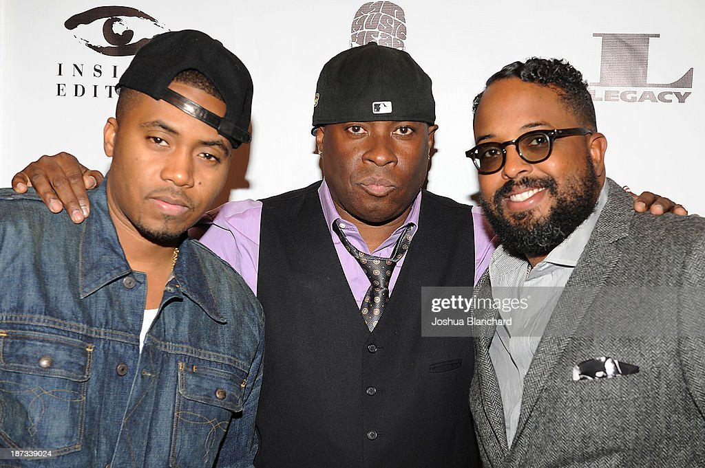 Rapper Nas, drummer Vince Wilburn Jr. and Erin Davis arrive at Mr. Musichead Gallery for the 'Miles Davis: The Collected Artwork' Launch Party on November 7, 2013 in Los Angeles, California.