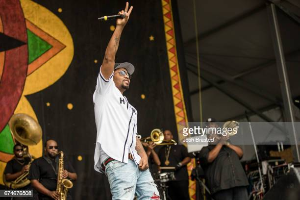 Rapper NAS performs with the Soul Rebels Brass Band at the New Orleans Jazz Heritage Festival at the Fair Grounds Race Course on April 28 2017 in New...