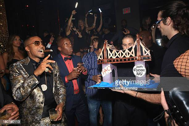 Rapper Nas poses for a photo with his birthday cake at his 40th birthday celebration with Hennessy VS at the Tao Nightclub at The Venetian Las Vegas...