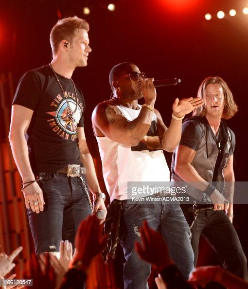 Rapper Nelly and musicians Brian Kelley and Tyler Hubbard of Florida Georgia Line perform onstage during Tim McGraw's Superstar Summer Night...