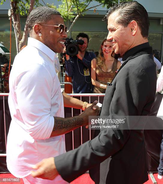 Rapper Nelly and singer El DeBarge attend the BET AWARDS '14 at Nokia Theatre LA LIVE on June 29 2014 in Los Angeles California