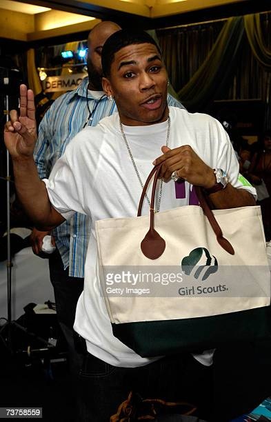 Rapper Nelly poses with the Girl Scouts display in the Distinctive Assets gift lounge during the 20th annual Kid's Choice Awards at Pauley Pavilion...