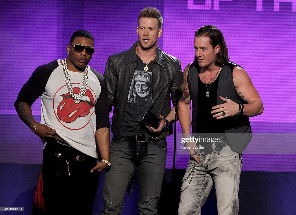 Rapper Nelly with singers Brian Kelley and <a gi-track='captionPersonalityLinkClicked' href=/galleries/search?phrase=Tyler+Hubbard&family=editorial&specificpeople=9453787 ng-click='$event.stopPropagation()'>Tyler Hubbard</a> of Florida Georgia Line accept the Single of the Year award for 'Cruise' onstage during the 2013 American Music Awards at Nokia Theatre L.A. Live on November 24, 2013 in Los Angeles, California.