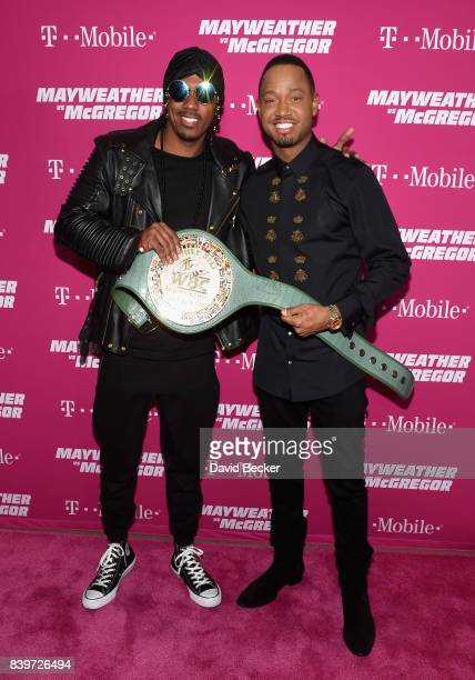 Rapper Nick Cannon and actor Terrence J pose with the WBC Money Belt on TMobile's magenta carpet duirng the Showtime WME IME and Mayweather...