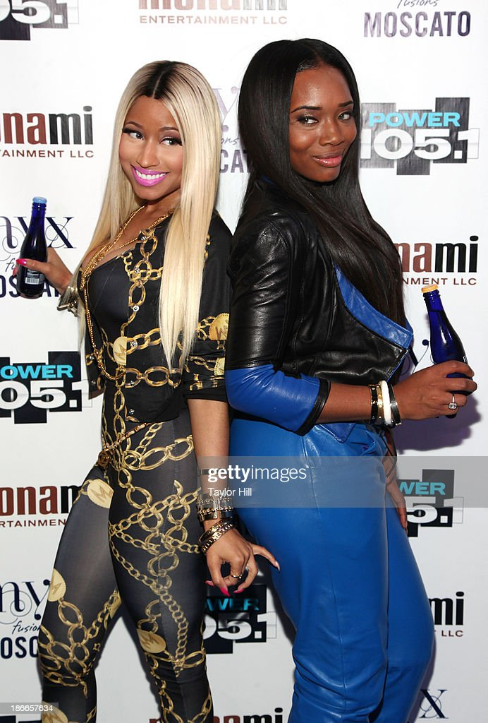 Rapper Nicki Minaj (L) and TV personality Yandy Smith attend Power 105.1's Powerhouse 2013, presented by Play GIG-IT, at Barclays Center on November 2, 2013 in New York City.