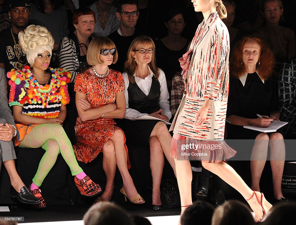 Rapper Nicki Minaj (L) Editor-in-chief of American Vogue, Anna Wintour and Creative Director of American Vogue, Grace Coddington (R) attend the Carolina Herrera Spring 2012 fashion show during Mercedes-Benz Fashion Week at The Theater at Lincoln Center on September 12, 2011 in New York City.