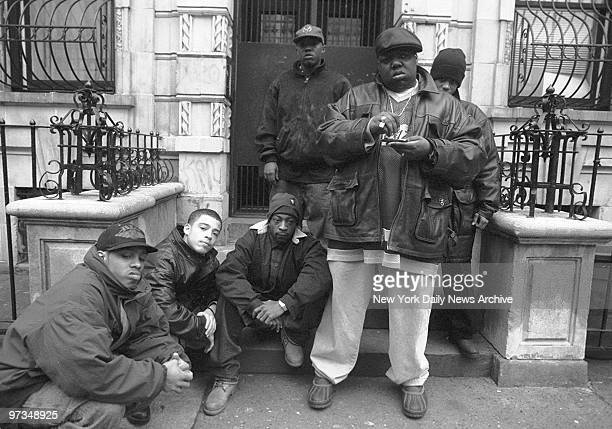 Rapper Notorious BIG aka Biggie Smalls aka Chris Wallace with Junior Mafia outside his mother's house in Brooklyn